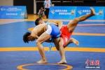 全国少数民族传统体育运动会:民族式摔跤 - 中国新闻社河南分社